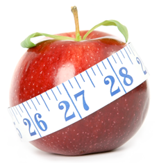 An apple that is being measured